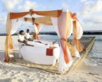 beachside massage at the Hilton Barbados Resort – courtesy hiltonbarbadosresort.com