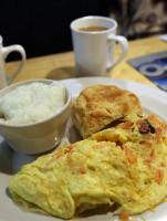 Alligator omelet, grits, and biscuit at Daisy Dukes