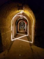 artistic lighting illuminates the passages