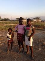 three local children near the new site